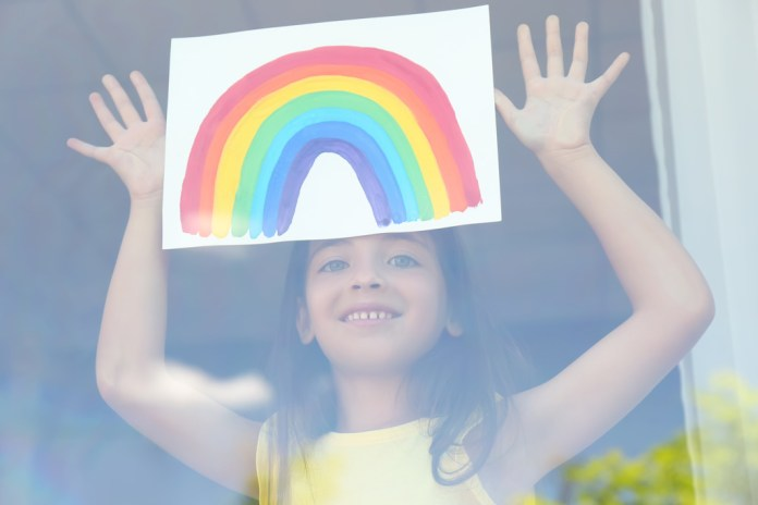 Little Girl Showing Her Rainbow Painting