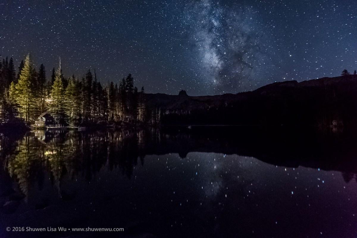 Stars and Milky Way reflect in Lake Mamie at night, Mammoth Lakes, California, September 2016.