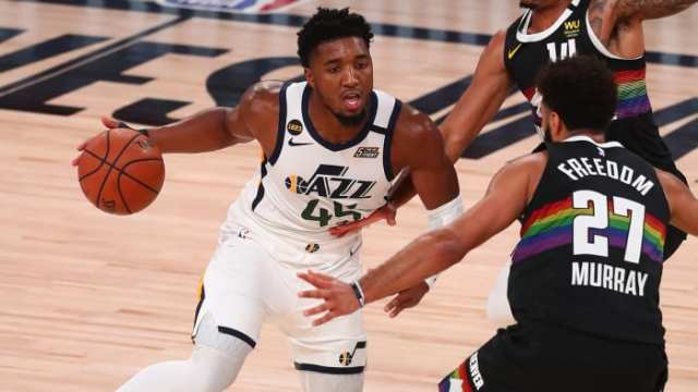 Donovan Mitchell dribbles against the Denver Nuggets