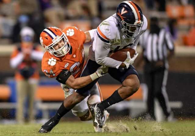 Clemson's Nolan Turner tackles a Virginia player