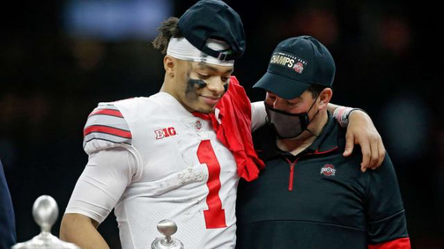 Ohio State Buckeyes head coach Ryan Day and quarterback Justin Fields (1) share a moment after Fields was awarded the Most Outstanding Player award after beating Clemson Tigers 49-28 in the College Fo...