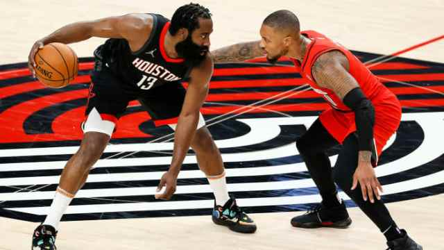 James Harden guarded by Damian Lillard
