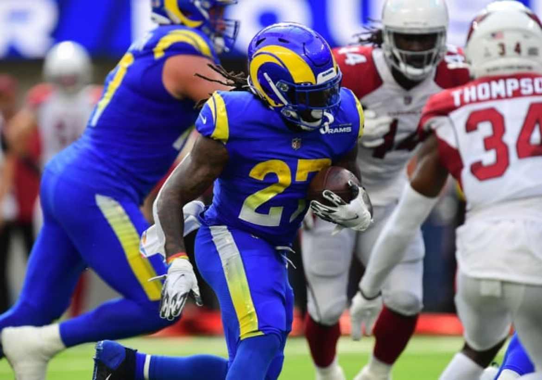Oct 3, 2021; Inglewood, California, USA; Los Angeles Rams running back Darrell Henderson (27) runs the ball against the Arizona Cardinals during the first half at SoFi Stadium. Mandatory Credit: Gary A. Vasquez-USA TODAY Sports