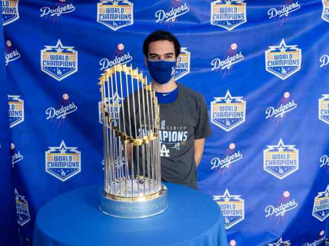 Mets director of baseball analytics Ben Zauzmer, who worked in the Dodgers' front office from 2015-20, poses with the 2020 World Series trophy.