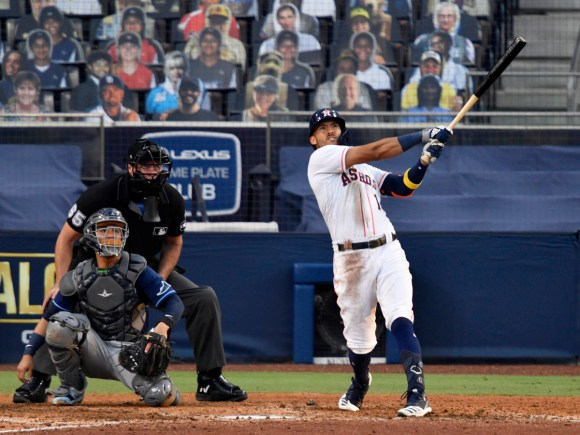Oct 15, 2020; San Diego, California, USA; Houston Astros shortstop Carlos Correa (1) hits a game winning home run against the Tampa Bay Rays in the ninth inning during game five of the 2020 ALCS at Petco Park.