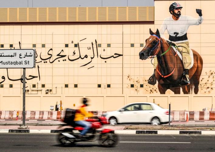The sheikh's equestrian image looms in Dubai.