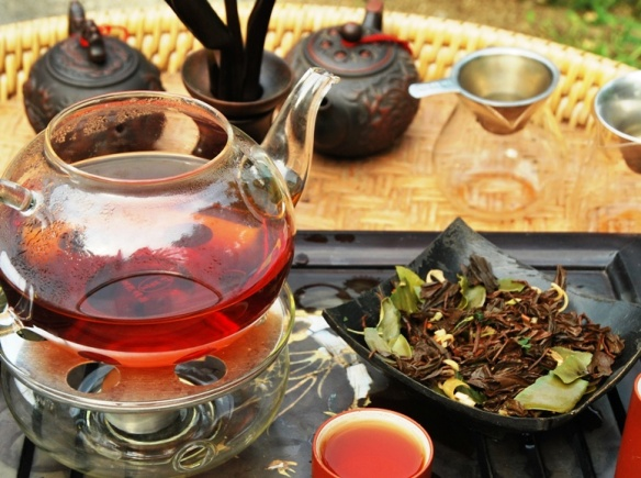 Siam Blend Black Thai tea blend enjoyed as hot tea , with wet leaves at the side