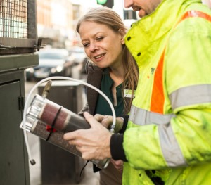 Sian inspecting the monitoring station at Putney High Street