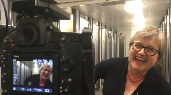 Caroline Russell filming in public toilet block