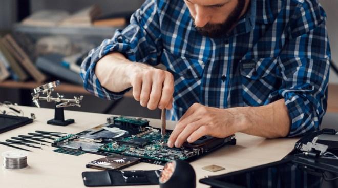 Man repairing laptop - credit Golubovy/stock.adobe.com