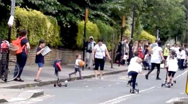School street in London with children playing
