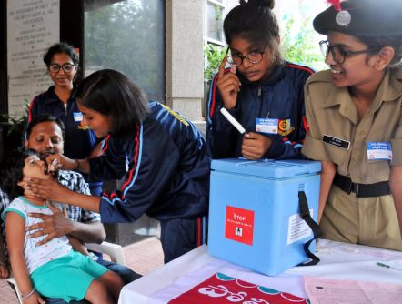 NCC cadets administrating Polio drops to infants at Niloufer Hospital in Hyderabad