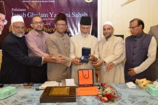 Advisors, KTT presenting a watch as a gift to Ghulam Yazdani