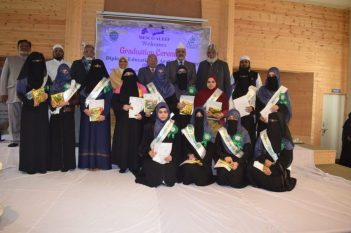 The toppers of D.E.A.L. course posing with dignitories with their certificates at the end of Graduation ceremony.