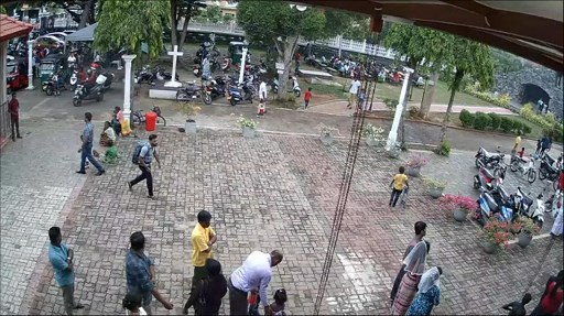 """This still image taken from Sri Lankan closed-circuit TV on April 21, 2019 shows a suspected bomber (L) with backpack on his way to enter St. Sebastian's Church in Negombo, Sri Lanka. - The Islamic State group on April 23, 2019, claimed responsibility for the devastating series of suicide attacks against churches and hotels in Sri Lanka that killed more than 320 people. (Photo by Handout / CCTV Sri Lanka / AFP) / RESTRICTED TO EDITORIAL USE - MANDATORY CREDIT """"AFP PHOTO / CCTV Sri Lanka"""" - NO MARKETING NO ADVERTISING CAMPAIGNS - DISTRIBUTED AS A SERVICE TO CLIENTS"""