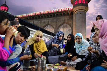 Families breaking their first fast of Ramzan at historic Mecca Masjid
