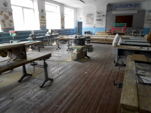 large room with woodworking equipment