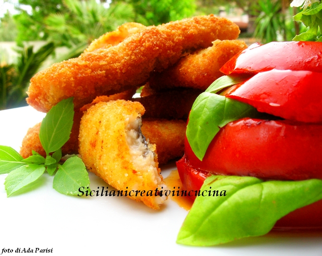 Bandera pescados chuletas con tomates a la plancha