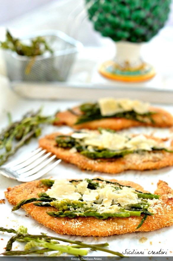 Chicken cutlets baked with asparagus and Parmigiano Reggiano.