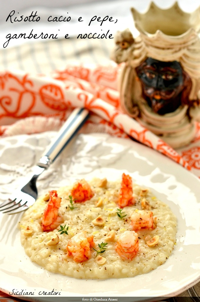 Risotto with cheese and pepper prawns and hazelnuts