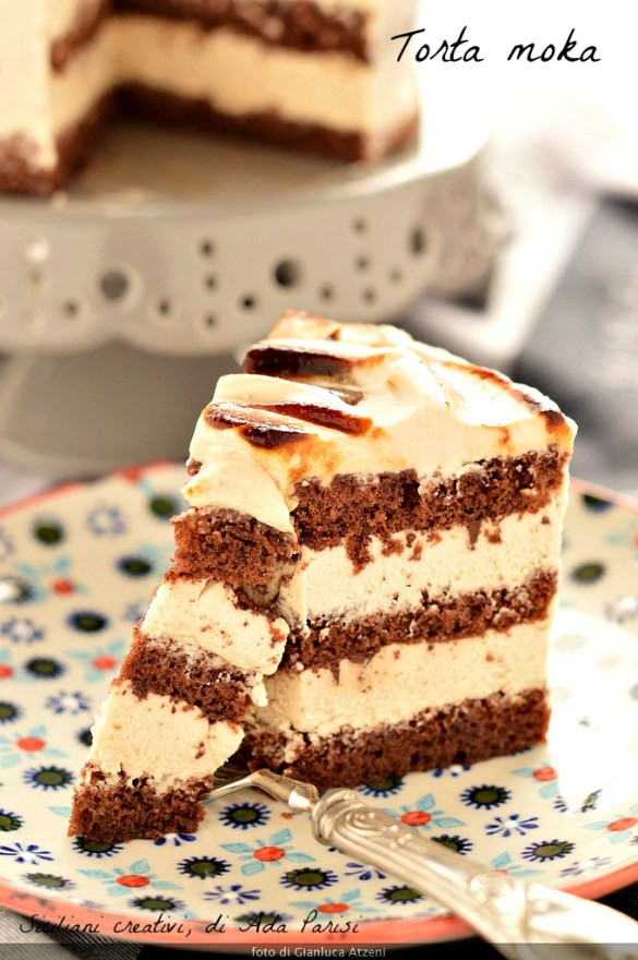 A slice of coffee cake, three layers of sponge cake with chocolate and a soft coffee cream