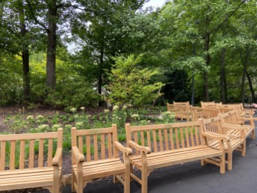 These new benches waiting to be positioned so visitors can enjoy the garden's views.