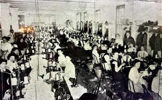 This screenshot from an online tour reveals the crowded working conditions at the area's garment factories during the early 20th century.