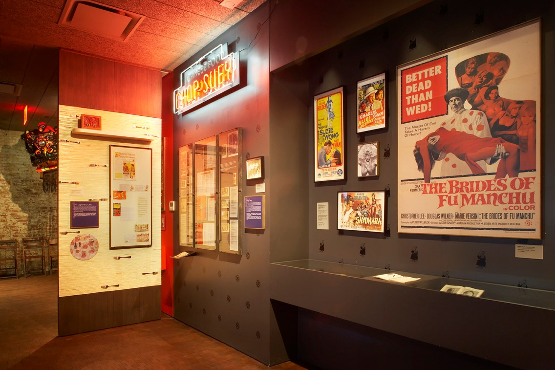 """Part of the """"With a Single Step: Stories in the Making of America"""" covers topics including Chinese stereotypes in Hollywood and the creation of chop suey as a way to attract tourists. Courtesy of Museum of Chinese in America"""