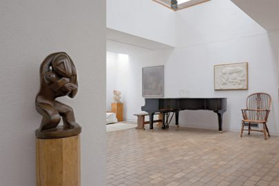 View of the extension's music area with piano and sculpture by Henri Gaudier-Brzeska. Photo by Paul Allitt courtesy of Kettle's Yard, University of Cambridge