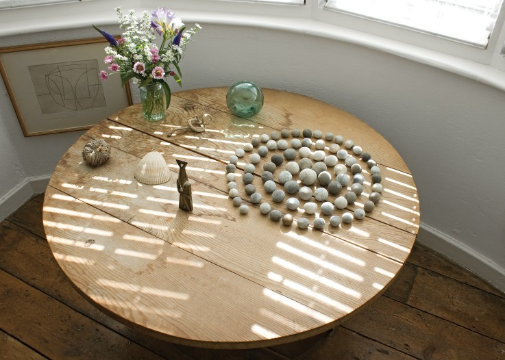 Jim Ede bedroom table with stones. Photo by Paul Allitt, courtesy of Kettle's Yard, University of Cambridge