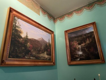 The West Parlor has copies of Cole's paintings, including one of nearby Kaaterskill Falls (on the right). It also shows an unrestored section of a frieze designed by Cole.