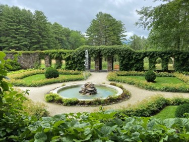 The sunken Italian Garden is a lush, private space with a portico for shade.