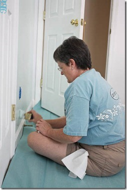 mom painting the nursery