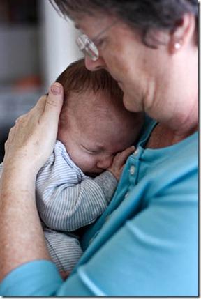 grandmother cuddling baby