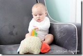 6 month baby plays with owl