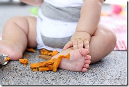 baby eating sweet potatoes