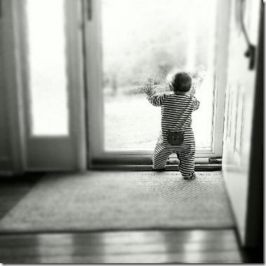baby standing at door