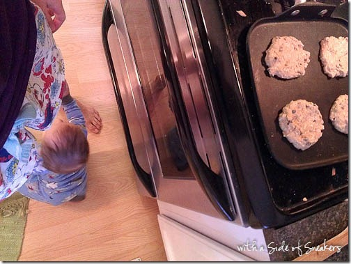 making pancakes with baby at feet