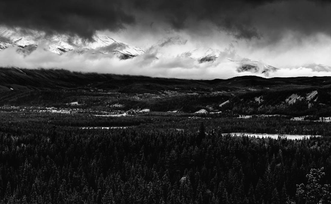 Black and white foggy morning overlooking the Athabasca Hanging Valley at Jasper National Park, Alberta landscape. Copy space horizontal.