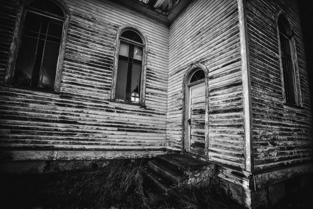 Spaca Moskalyk sunrise exterior showing the side stairs and remaining stained glass windows outside of Mundare, Alberta deserted structures.