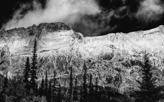 Black and white Canadian Rockies Alberta landscape of the Colin Range covered in snow during an early autumn day at Jasper National Park.