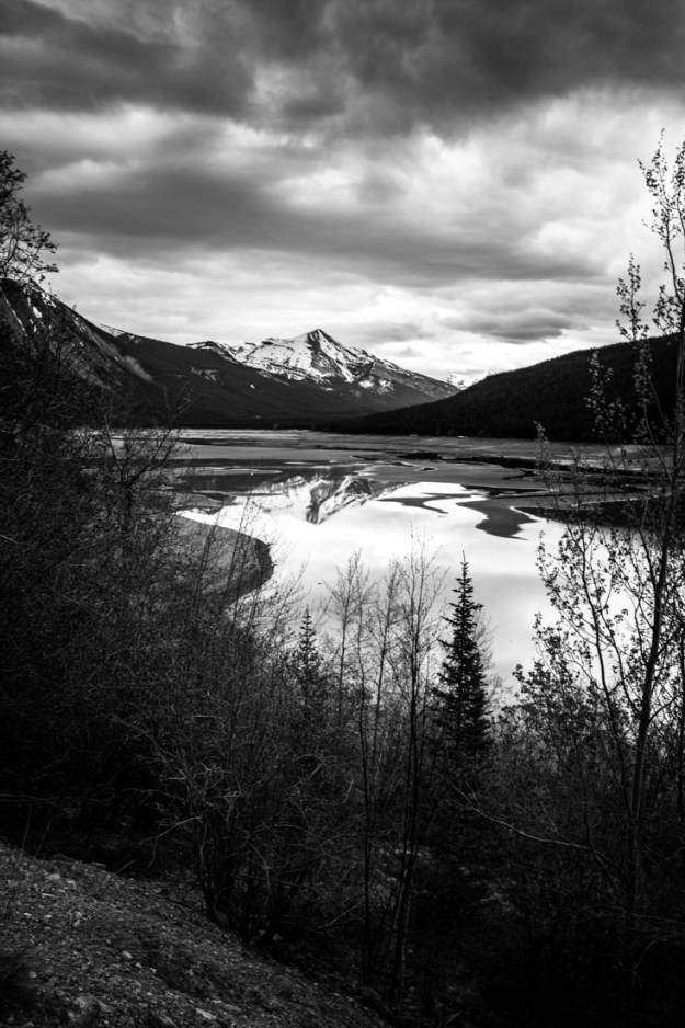 Medicine Lake, Jasper National Park, a geologic anomaly which is a mudflat with scattered pools of water connected by a stream, captured here during mid-spring runoff. Alberta black and white fine art landscape.
