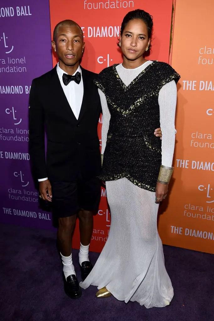 Pharrell Williams (L) and Helen Lasichanh