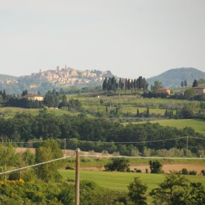 image of the Tuscan hill town Montepulciano taken from the garden at Siena House and visible from the windows of the room named Montepulciano