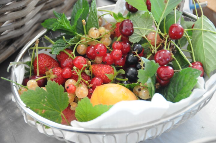 Image of a basket of our home grown berries and cherries
