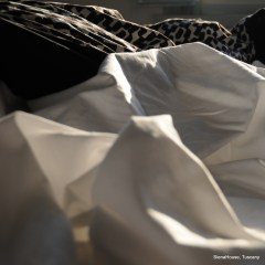 Image of black and white bed linen with the sun on it showing the texture