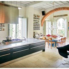 image showing open plan kitchen in luxuious design filled interior of modernised tuscan villa near pienza