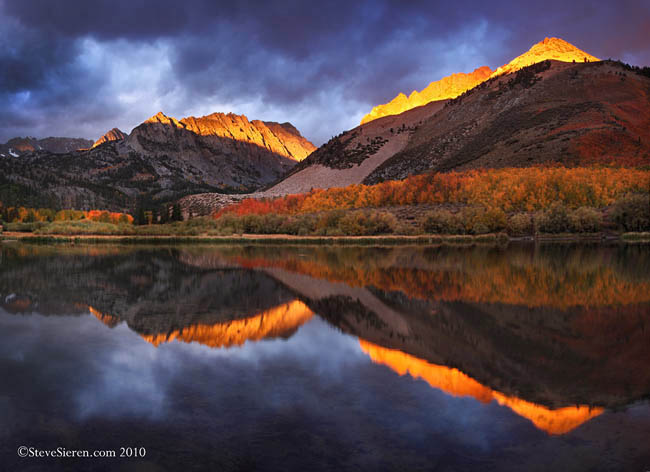 Alpen glow breaks through the clouds in the Eastern Sierra's North Lake on a cold autumn morning.