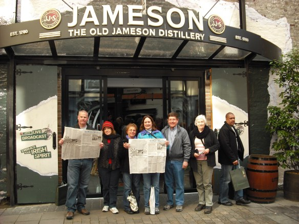 Lou, Diane, Karen, Mary, Charles, Barbara and an unknown tourist read the Mountain Messenger in Ireland