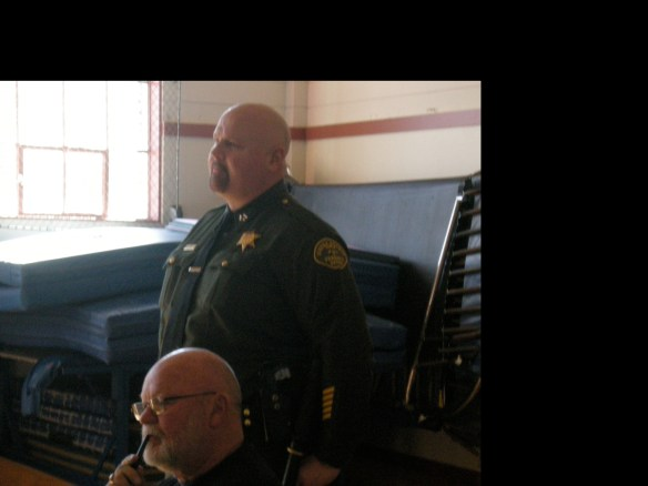 Sheriff John Evans and Supervisor Peter Huebner pay attention